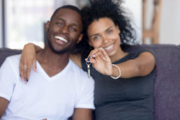Couple purchase property woman holding keys