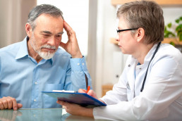 Man discusses medical issues with doctor